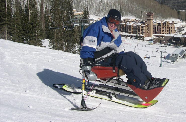 Man on Red Ski