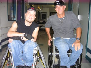 2 disabled men in a wheel chair