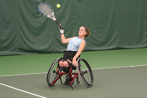 A lady in a Wheelchair Tennis
