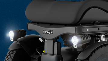 A Wheelchair with LED headlights.