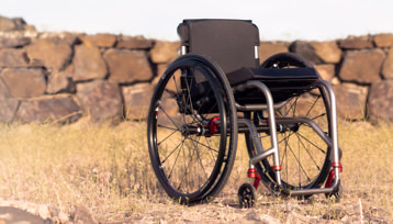 A mid-side Wheelchair on the grass.