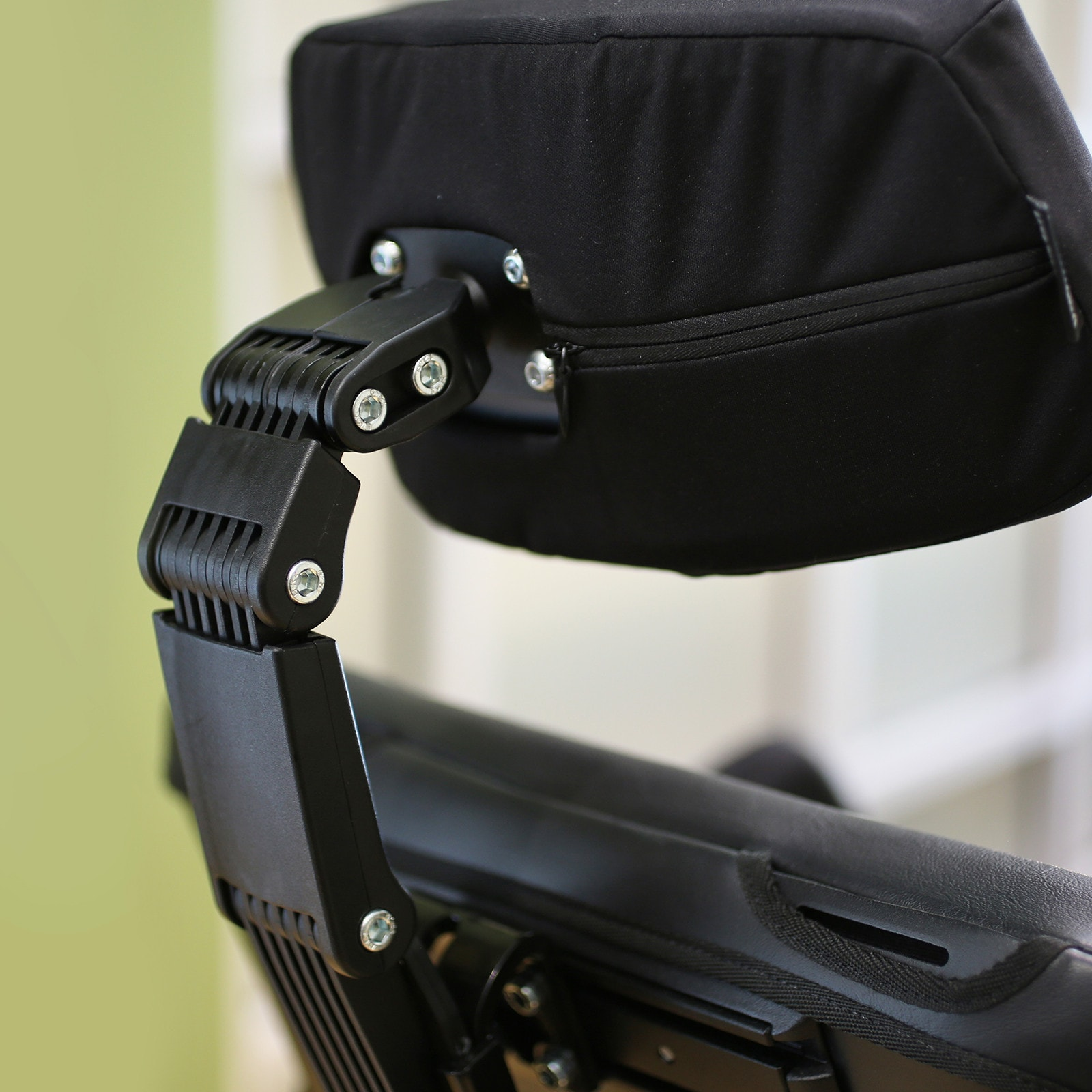 A black head support of a Wheelchair.