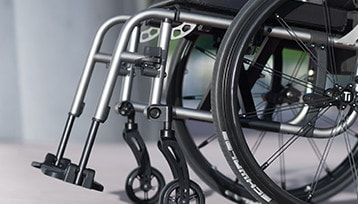 The wheelchair footplates, footrest and wheels.