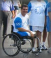 A disabled man wearing white-blue shirt on his Manual Wheelchair