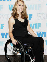 A lady wearing black gown on her Manual Wheelchair