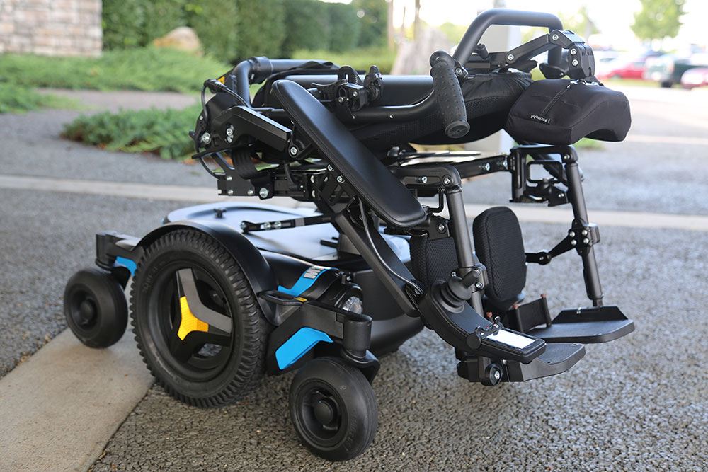 A back left side foldable backrest wheelchair.