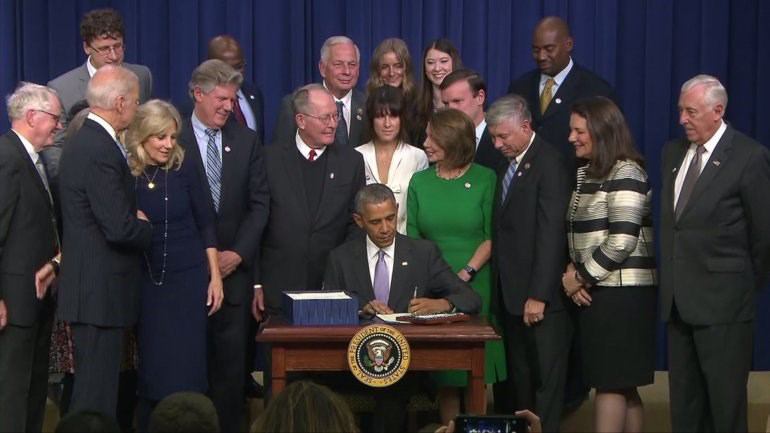 President Obama signs the 21st Century Cutes Act into Law.