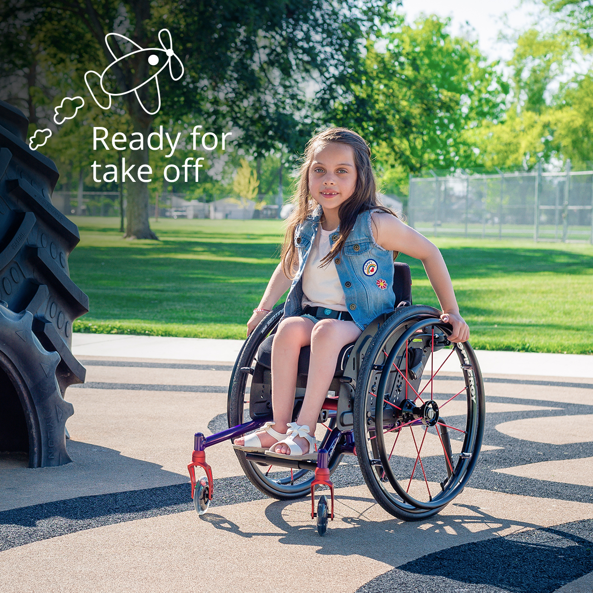 A girl on a Wheelchair is ready for her take off.
