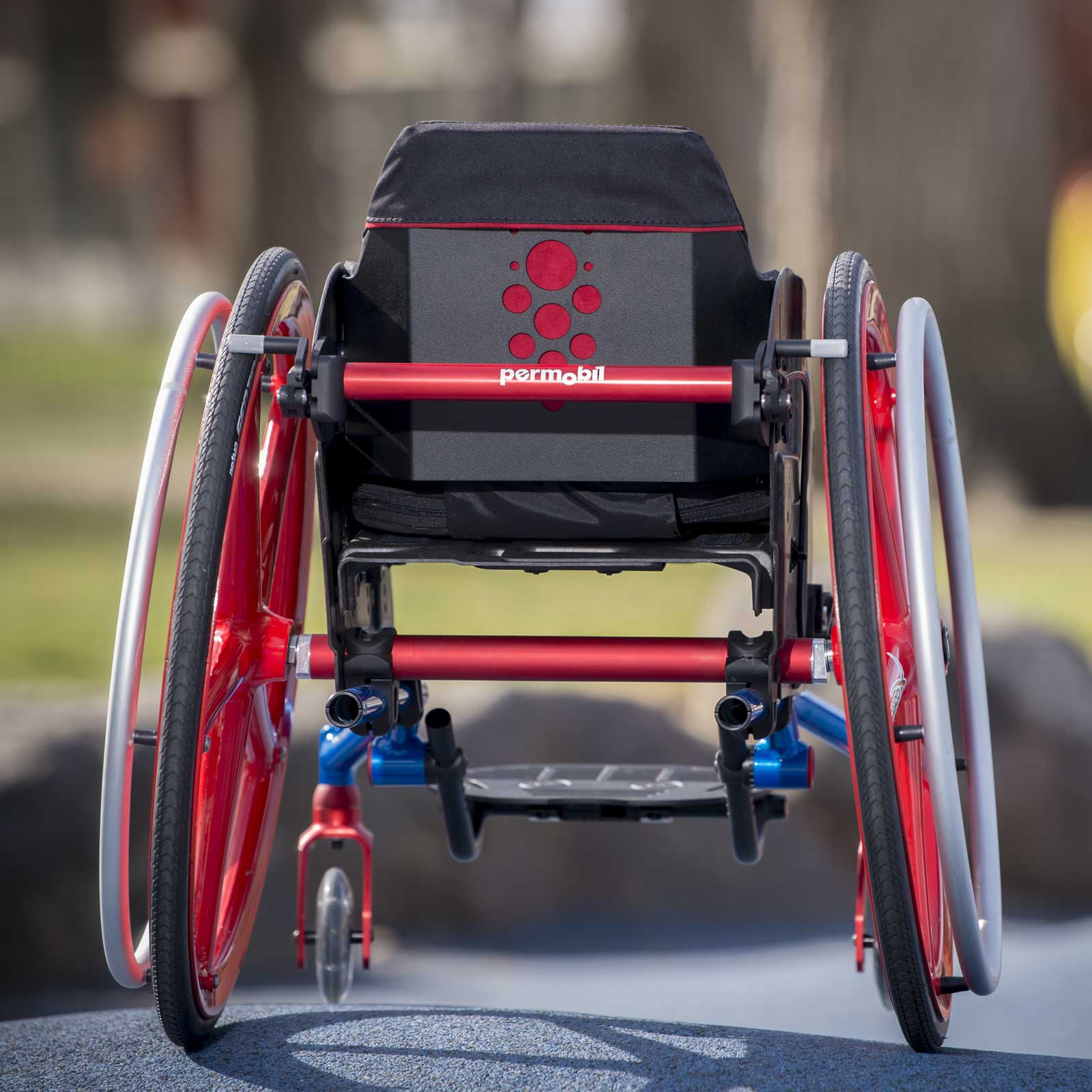 Permobil Red Back view of TiLite Pilot Wheelchair