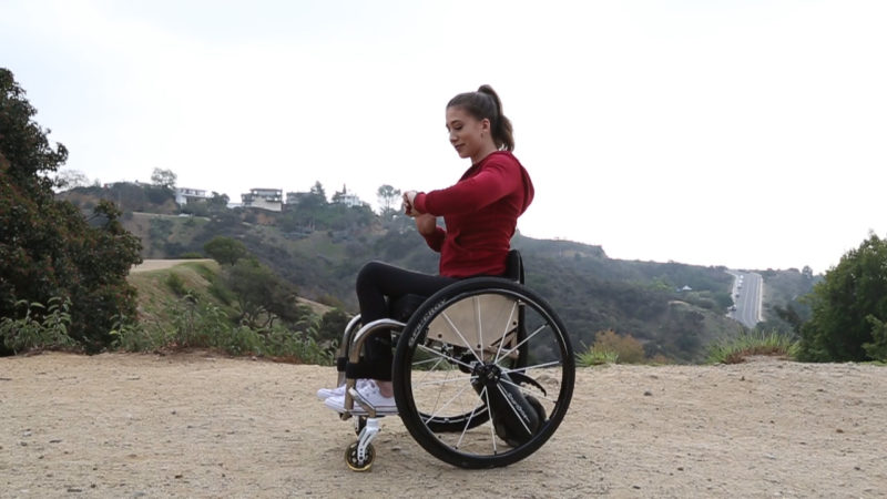 A lady using a smart drive wheelchair