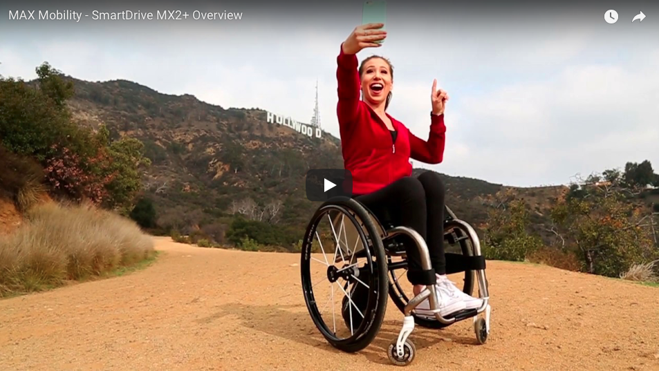 A Girl taking a selfie on her wheelchair