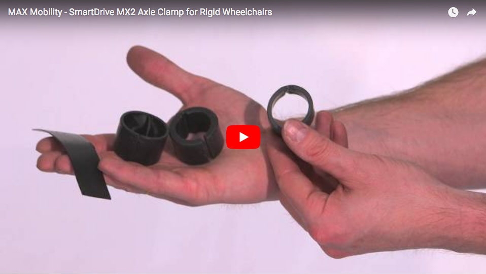 Man holding MX2 Axle Clamp for Rigid Wheelchair