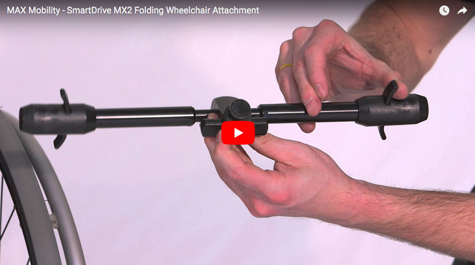 Man Holding MX2 Folding Wheelchair Attachment