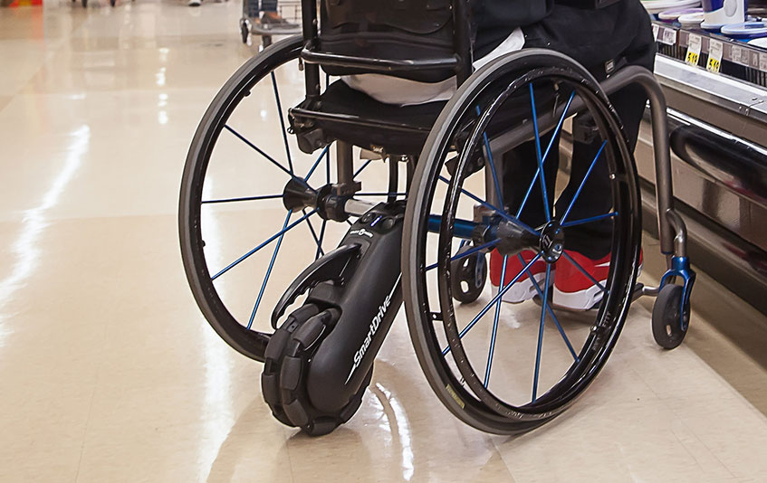 A manual wheelchair using smartdrive